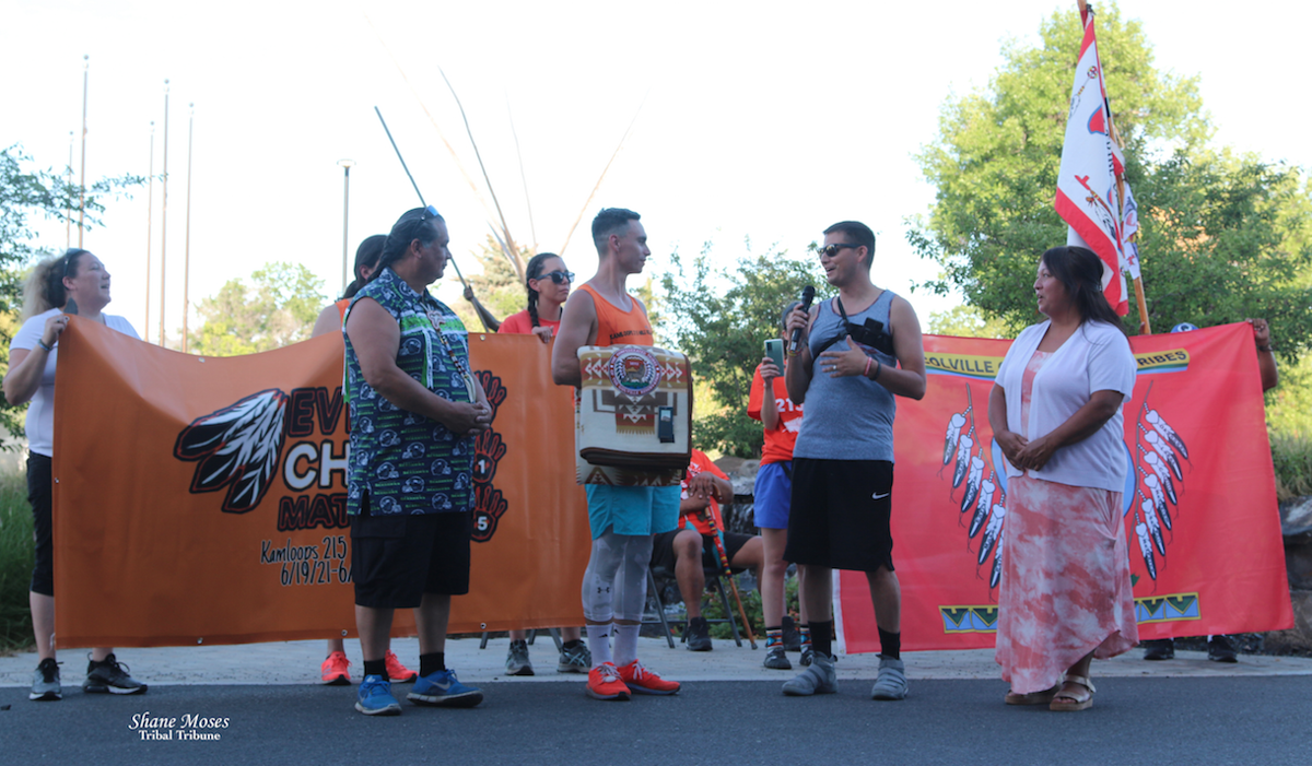 Colville Business Council members Andy Joseph Jr., Jarred-Michael Erickson and Sharlene Zacherle present Spokane Tribal member Danny Brigman with a Pendleton blanket following the 215 mile relay run from the Spokane Reservation to the Lucy Covington Government Center, June 20