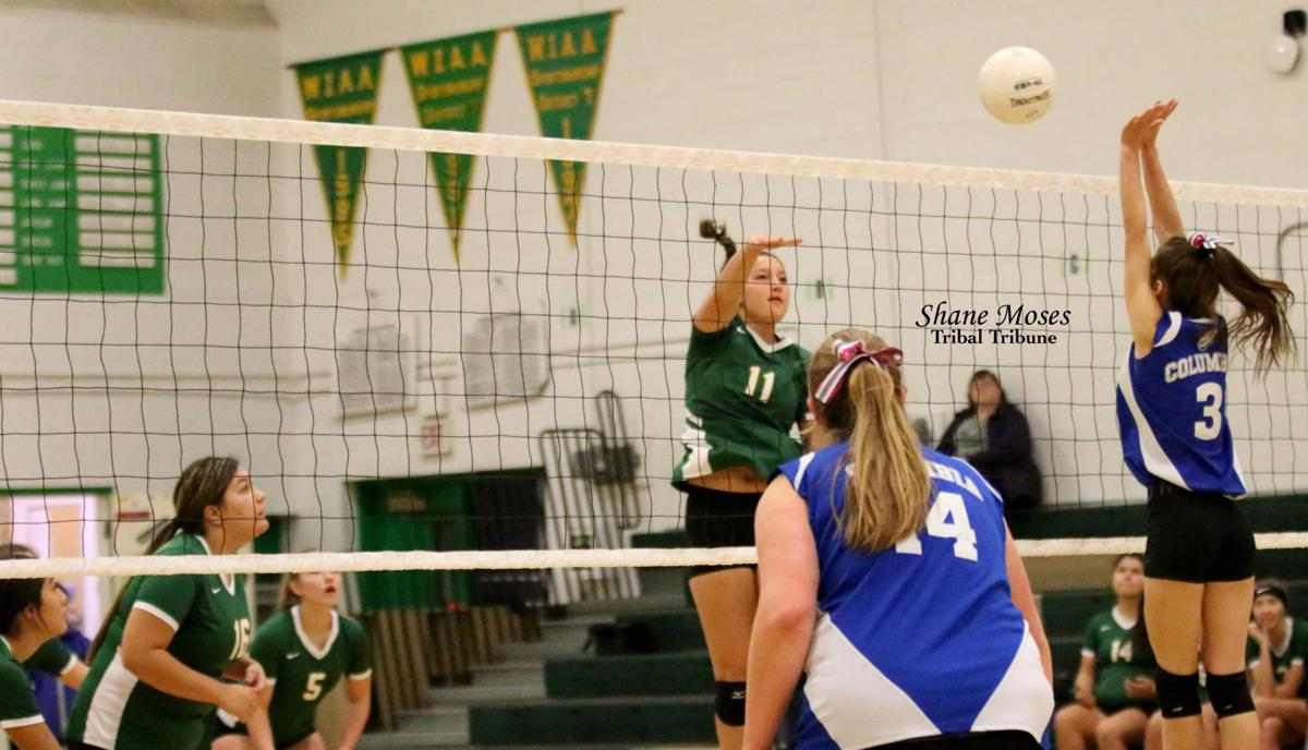Colville tribal member Rylee Desautel (#11) of Inchelium spikes a shot against Columbia on Saturday (Oct. 12) afternoon