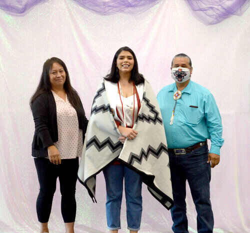 CBC Shar Zacherle and CBC Chair Andy Joseph Jr. (Blue shirt) stand with Melissa Meza at the graduation Ceremony on Aug. 20 at the Lucy Covington Government Center