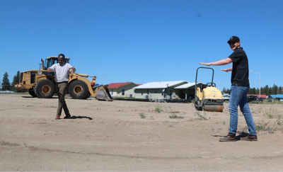 LEFT TO RIGHT: Sanjay Rajan and Colville Tribal member Macoti Fox stand in a drawn out circle where they have plans and hopes of making two geo-domes for the production of fresh food for local tribal members.
