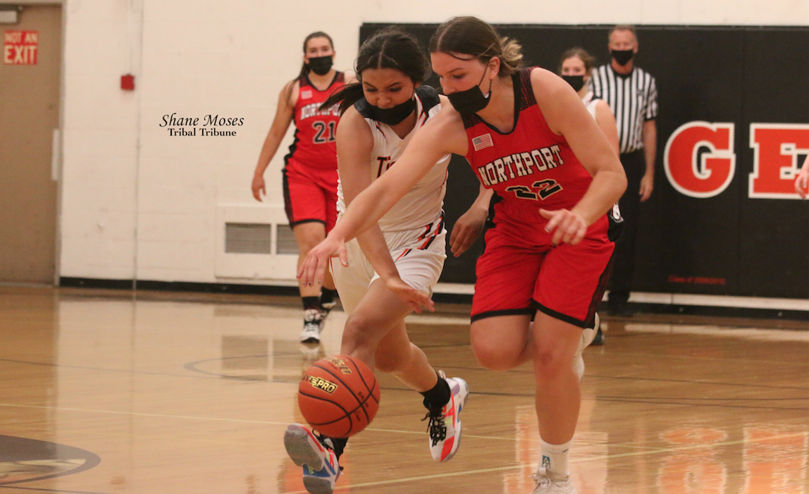 Colville tribal member Kayla Tonasket (#24 white) of Republic steals the ball away from Northport (June 2) in NE 1B League action