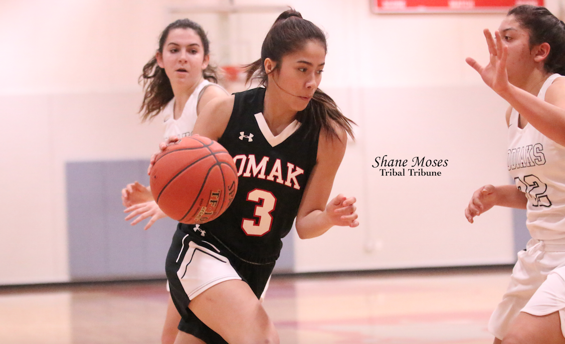 Tribal member Paris Marchand (#3 black) of Omak drives to the hoop against Cascade on Friday (Jan. 17) night.