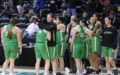 Rylee Desautel gives a hug to teammate Cloey Simpson after the Lady Hornets lost to Sunnyside Christian 62-41 on Wednesday afternoon at the WIAA 1B Girls State Tournament