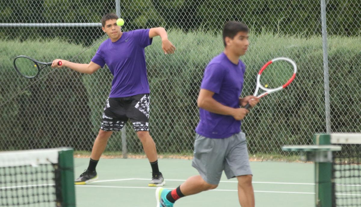 Tribal member Aidan Hall of Pateros gets ready to smash a forehand shot against La Salle on Saturday (May 25) evening at the 1B/2B/1A state tennis tournament held at the Yakima Tennis Club