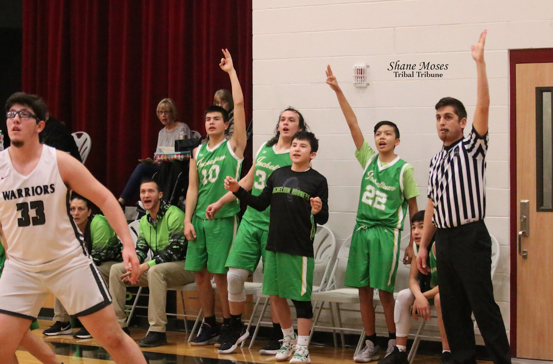 Players on the Inchelium bench stand up and cheer for their teammates as they battle A.C.H on Feb 11 in the first round of the NE 1B District Tournament.