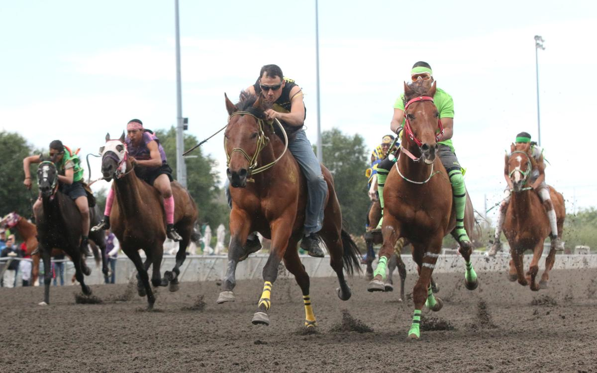 Action shots from the first consolation race of the third annual Muckleshoot Gold Cup at Emerald Downs racetrack in Auburn, Wash on Sunday afternoon.