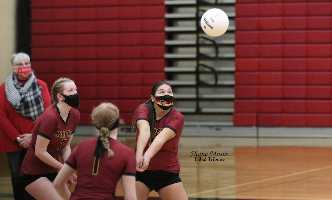 Colville tribal member Raven Clark (#8 maroon) of Lake Roosevelt passes the ball to a teammate against Omak in the third set on Saturday (April 3) afternoon in non-league action. Lake Roosevelt went on to win the set (25-23) and the match 3-0