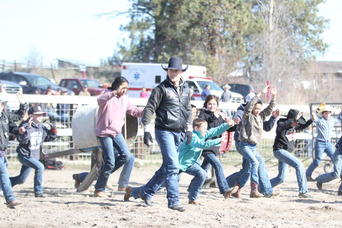 Shane Proctor (Black leather coat) has his students stretch and limber up before they get ready to get on any stock at this year's Bull riding/Steer School on April 2-3