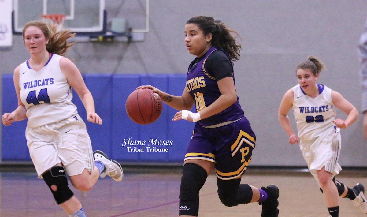 Colville tribal member Aleeka Miller-Smith (#10 purple) of Pateros dribbles the ball up court against Wilbur-Creston on Dec. 13 in non-league action