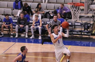 Dedrick Pakootas (#1 white) goes up for a lay in against Blue Mountian in the final game of the regular season on Thursday evening (Feb. 28)