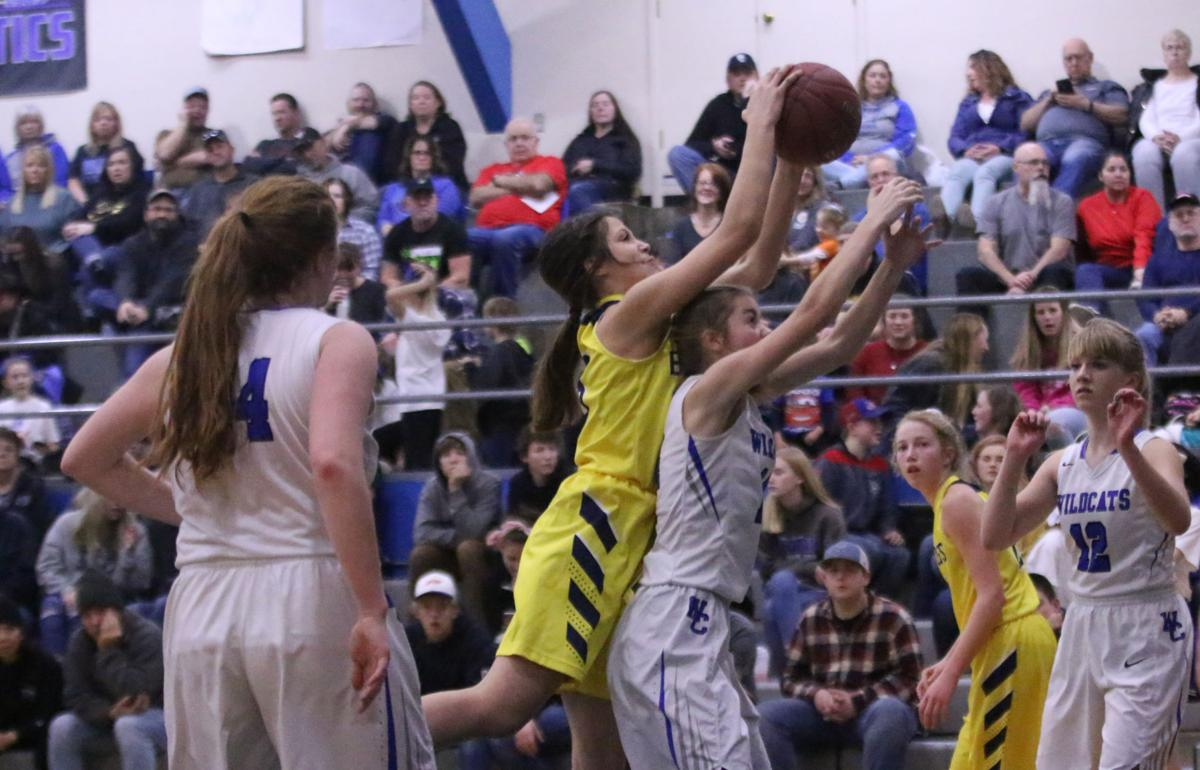 Joslynn Meusy (Yellow) of Kettle Falls goes up and grabs a rebound against Wlibur-Creston in NE 2B North League action on Friday evening