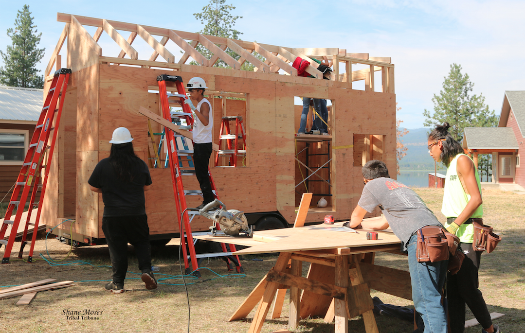 Youth workers are busy working on their Tiny House Project at Twin Lakes Youth Camp on the morning of Aug. 10
