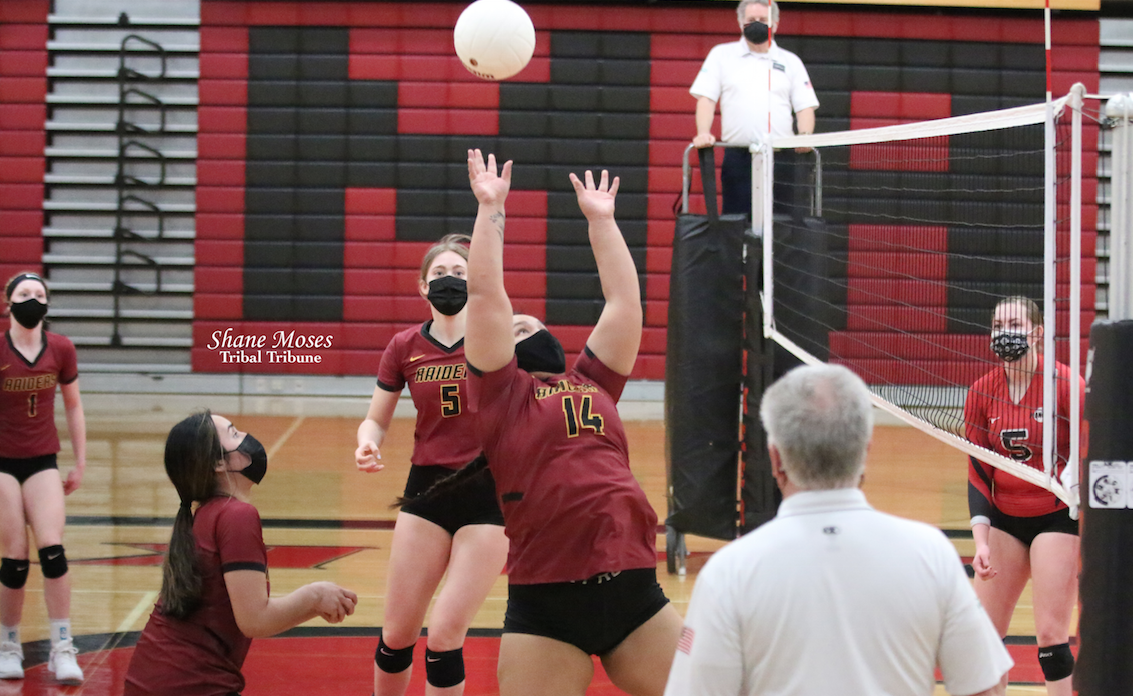 Colville tribal member Desiree George (#14 maroon) of Lake Roosevelt hits the ball back into play against Omak in the second set on Saturday (April 3) afternoon
