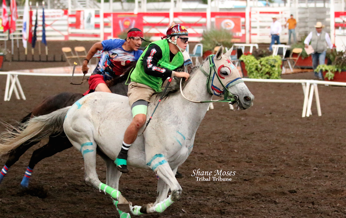 Terrence Holford (green) jockey for Arrow Lakes Express gets off to a fast start on Sunday's Consolation Championship race at the Walla Walla County Fair grounds