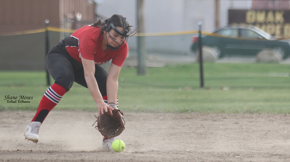 Colville member Trinity Fjellman shortstop for the Pioneers fields a ground ball on Friday (April 23) afternoon against Cascade in the first game of a doubleheader
