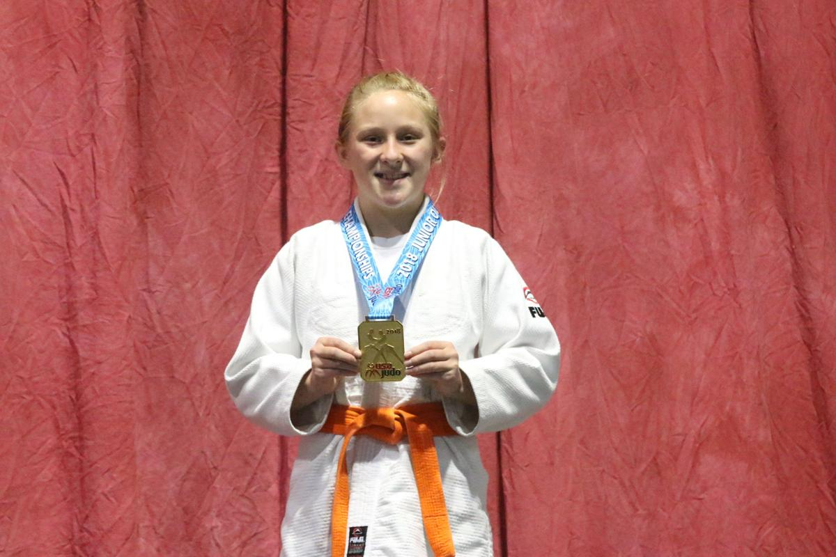 Colville tribal member Jaid Hunter holds up her gold medal she won this past weekend at the Judo Junior Olympic National and International Championships held at the Spokane Convention Center June 22-24