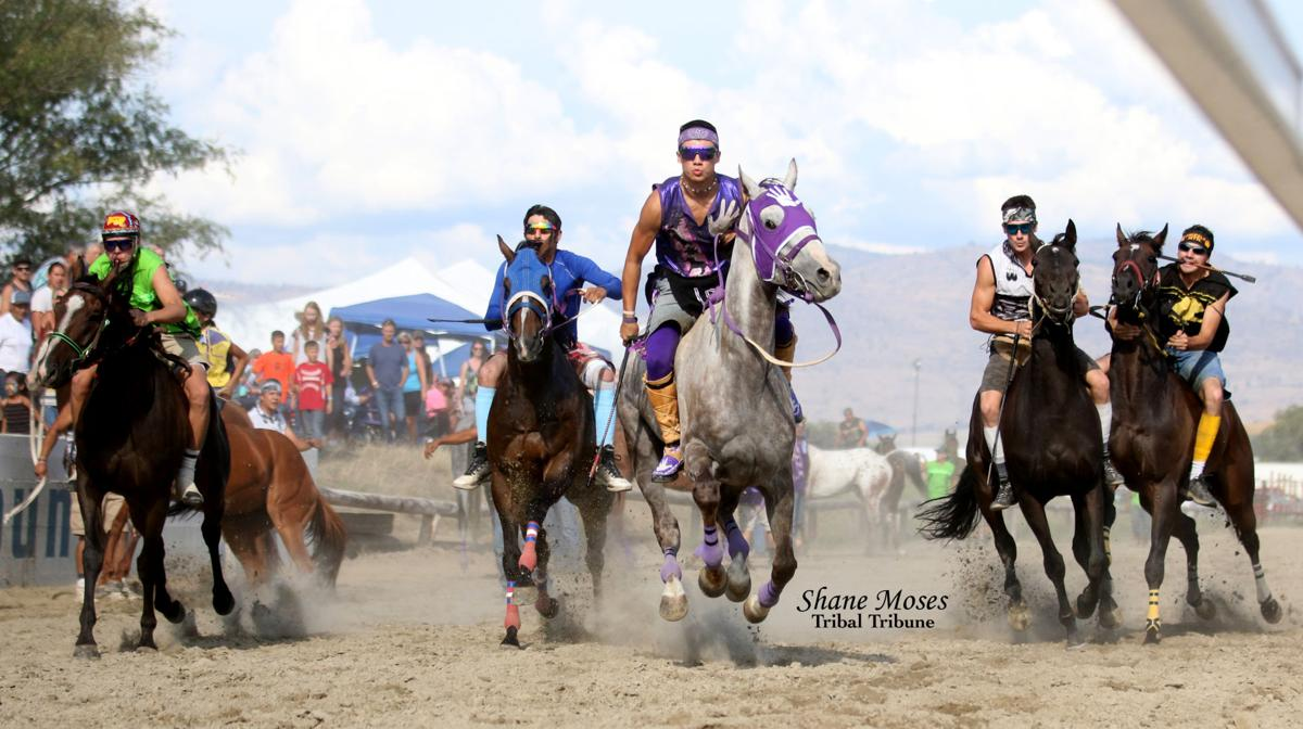 Scott Abrahamson (Purple) jockey for Abrahamson Relay pictured middle gets off to a good start in Saturday's race at the Okanogan County Fair Indian relay races