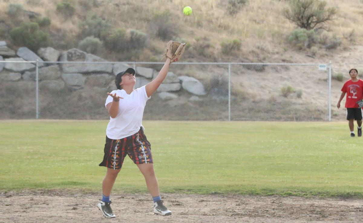 Tribal member Chasity Williams of Lookin 2 Score catches a fly ball against Team Boo Yaa on Tuesday (July 10) evening in GCD Co-Ed softball league action