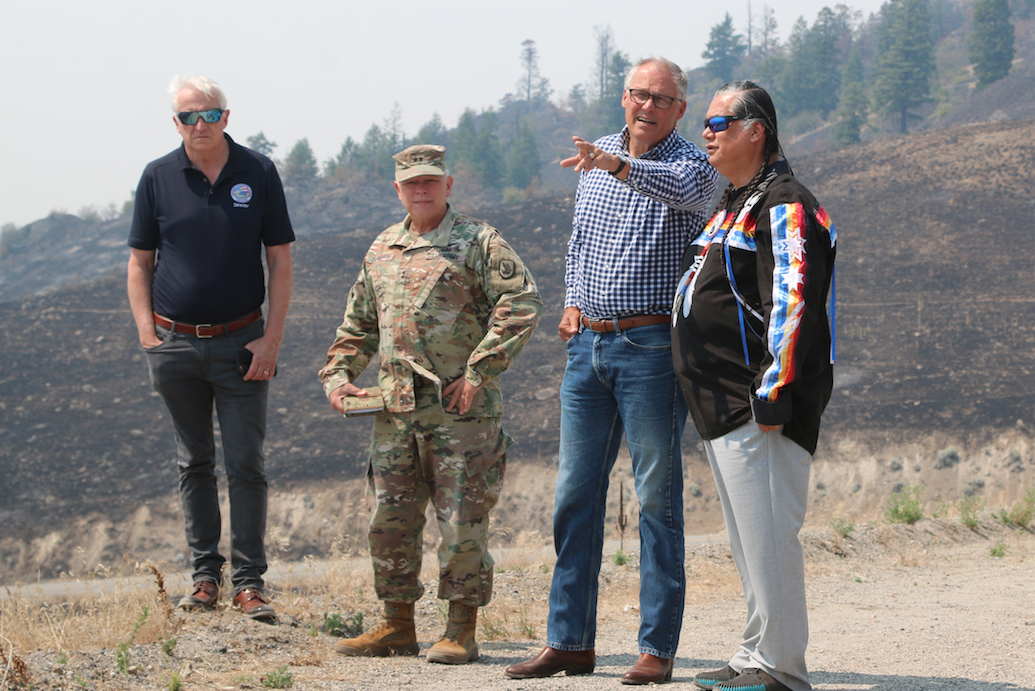 Colville Business Council Chair Andy Joseph Jr. and Washington Governor Jay Inslee look out over the Colville Tribal Agency, July 21, in Inslee's visit to meet with the CBC, fire management teams and the Nespelem Community