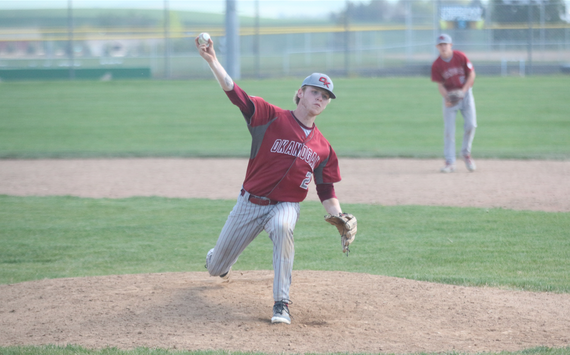 Kolby Picard (#2) of Okanogan pitches against Freeman on Saturday afternoon