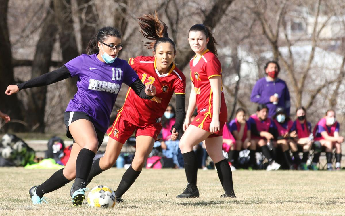 Colville tribal member Aleeka Miller-Smith (#10 purple) of Pateros dribbles the ball up field against Lake Roosevelt's Kyona Edmo (#12 red) on March 25.