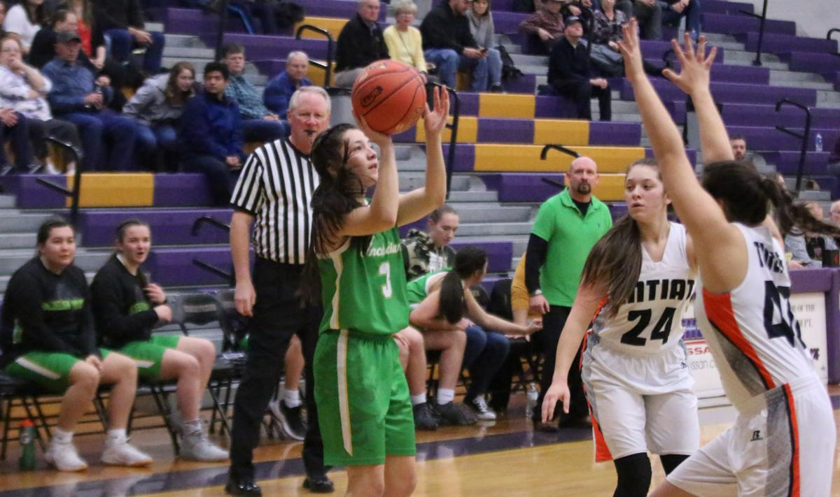Colville Tribal member Emily Zacherle (#3 green) of Inchelium gets a shot up against Entiat on Friday evening in Regional Tournament action at Wenatchee High School