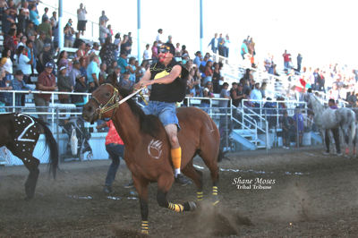Oliver Pakootas, jockey for Grizzly Mountain, gets ready for his third and final transfer in the championship race at the NCW Fair and Indian relay races on Sunday (August 25) afternoon in Waterville