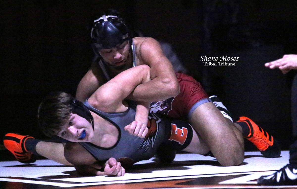 Kyler Romero (Colville member) of Toppenish (red singlet) works an armbar against Ephrata's John Shea IV in the 145-pound match on Jan. 30.
