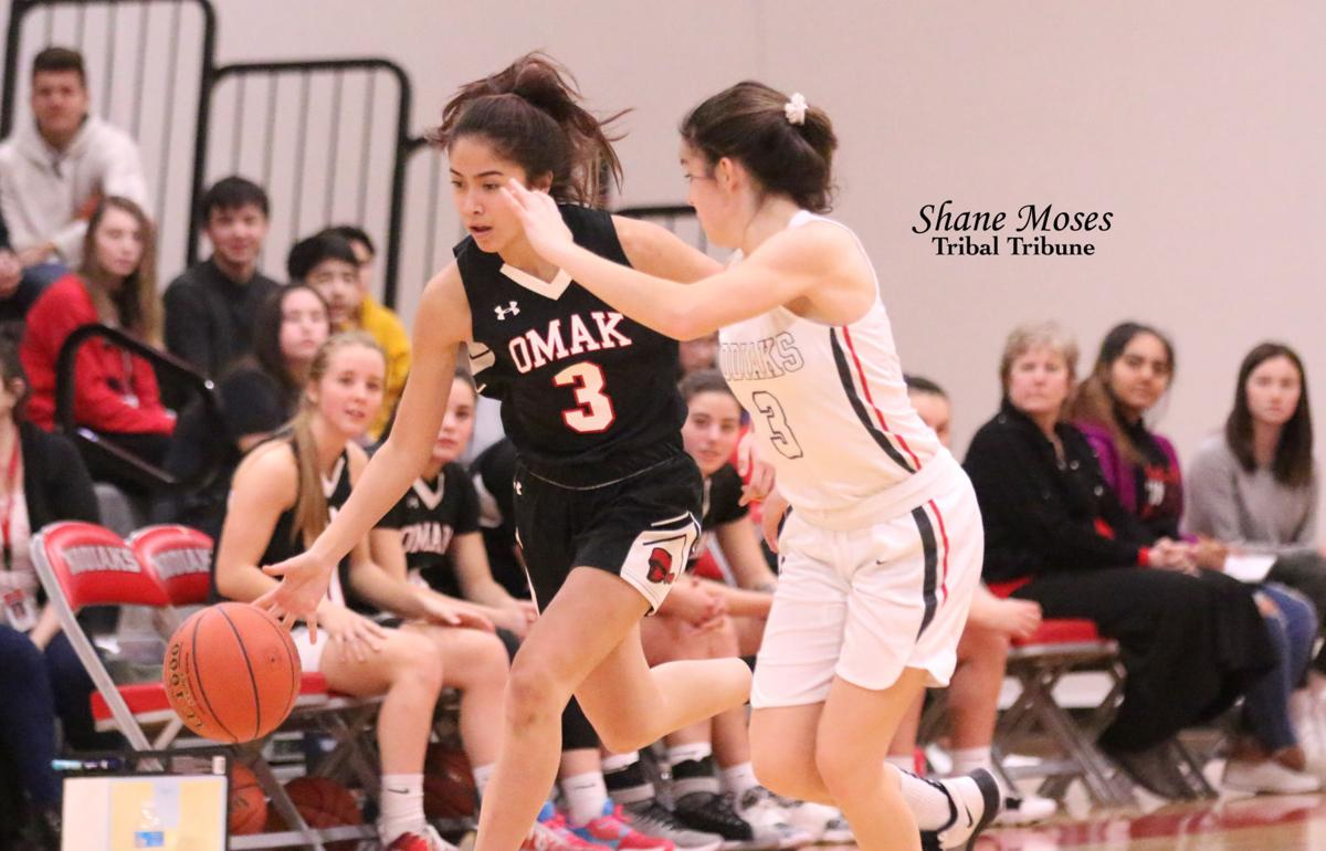 Tribal member Paris Marchand (#3 black) of Omak dribbles to the hoop against Cascade on Friday night. Marchand is one of four freshman on this year's varsity squad, Alyssa Davis, Sedeaju Michel and tribal member Aaliyah Marchand are the other three.