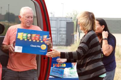Douglas County residents donating water and non-perishable food items.