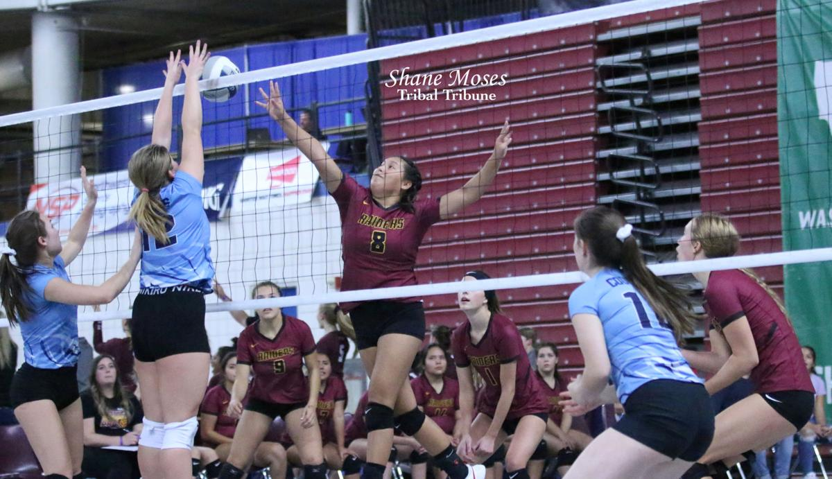 Colville tribal member Raven Clark of Lake Roosevelt pushes a shot over the net against Chewelah in the WIAA 2B State Volleyball Tournament at the Yakima Valley SunDome on Thursday (Nov. 14) evening