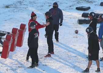 Omak Football Coach Eric Sackman addresses his team during practice, Feb. 17 in Omak.
