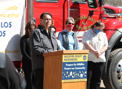 Colville Business Council Chair Rodney Cawston speaks at the launch of Wildfire Ready Neighbors with Commissioner of Public Lands Hilary Franz, April 19.