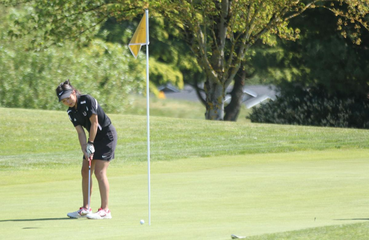 Callie Mills of Union High School putts near hole 11 at the 4A GSHL District Tournament at Tri-Mountain Golf Course on May 6