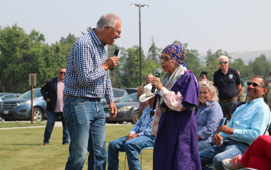 Washington Gov. Jay Inslee talks with Colville tribal elder Darlene Wilder about her family's experience with the Chuweah Creek Fire at the Colville Tribal Agency, July 21 during a public forum following the governor's meeting with CBC