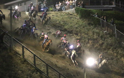 Oliver Pakootas and Onyx lead the way down the hill as the rest of the field follows on Friday night