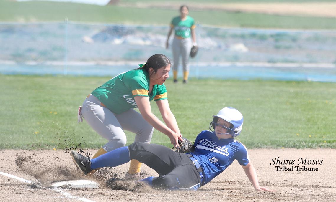 Colville tribal descendant Grace Kohler, third baseman for Inchelium tags out a Wilbur-Creston base runner on (May 4)