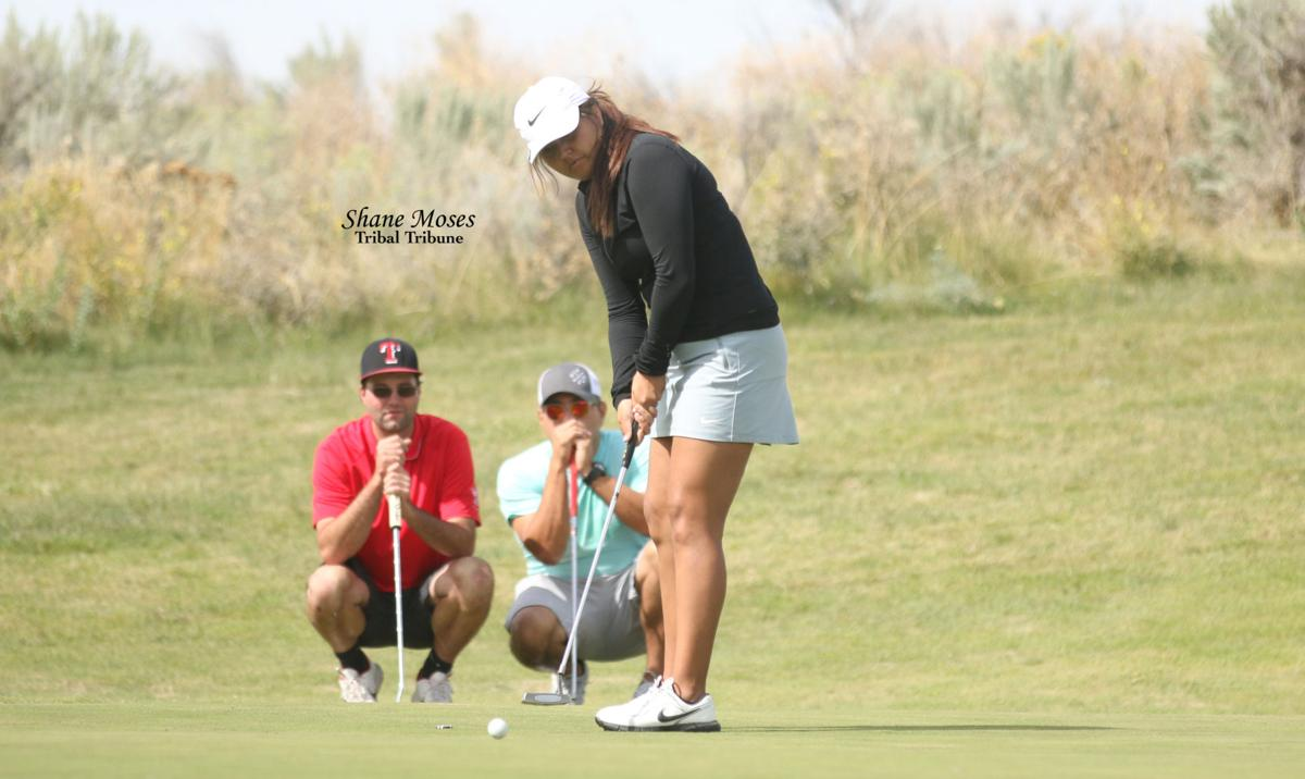 Rachel Arthur (Colville Tribal Member) gets ready to putt on Saturday afternoon at the 11th annual Rattler Open