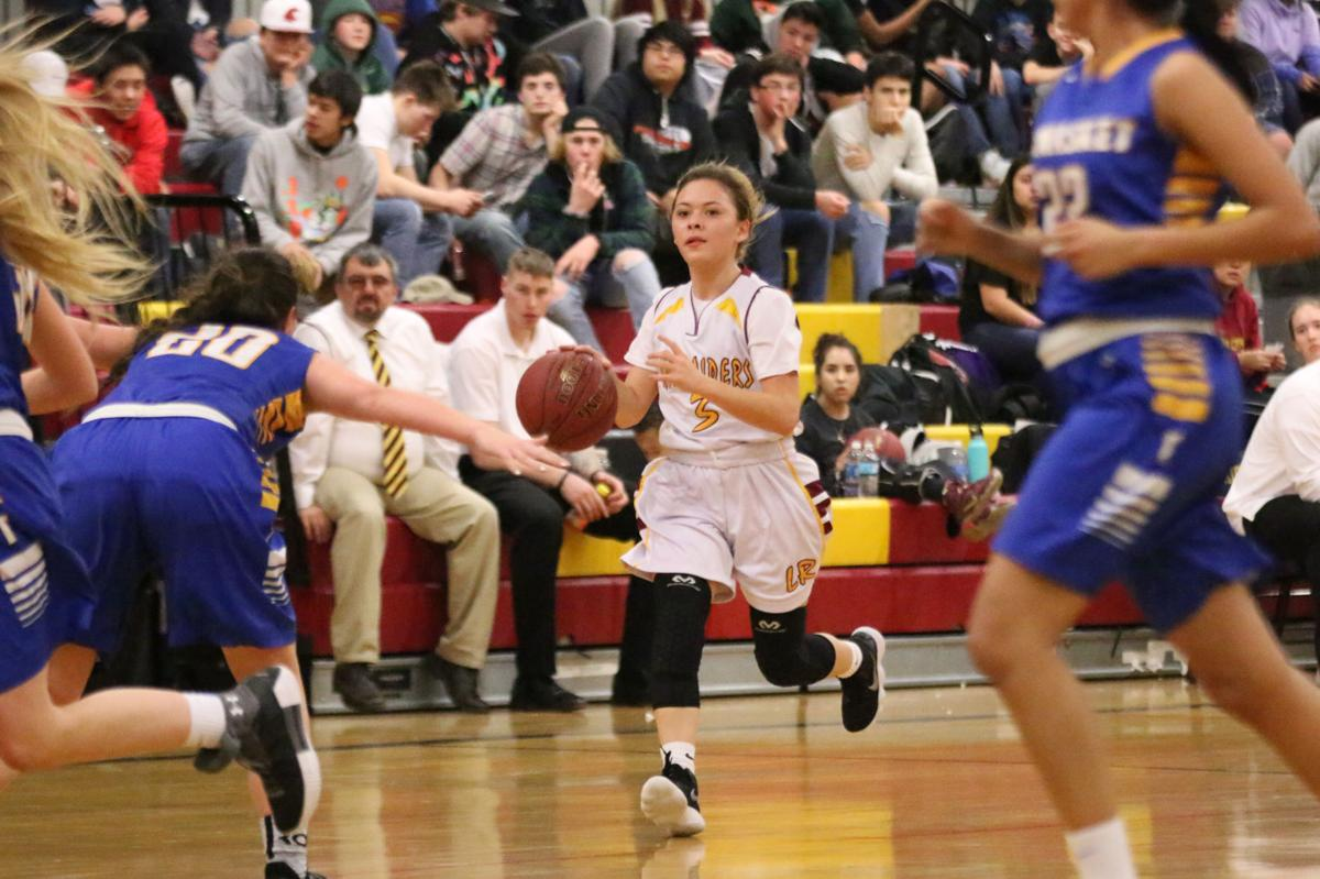 Colville tribal member Shantana Pakootas of Lake Roosevelt dribbles the ball down the court against Tonasket in Coulee Dam on Wednesday evening in Central Washington 2B League play