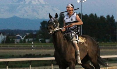 Omak Express' Tyler Peasley lopes out his final horse following Friday's 9 p.m. relay race at Emerald Downs. Peasley went on to finish third in Sunday's championship race.