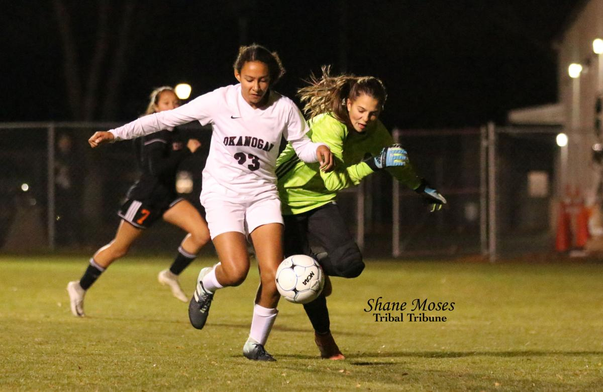 Daniele Sparks (tribal member) of Okanogan battles the Cashmere goalie for the ball on Tuesday (Nov. 5) evening as both schools clashed in the Caribou Trail League girls soccer tournament