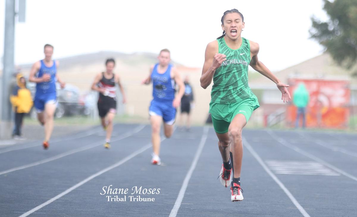 Colville tribal member Issac Hoskie of Inchelium (Green jersey) nears the finish line in the 400-meter championship race at the District 7 and 9 Track and Field Championships (May 7) at Ritzville High School. Hoskie placed second in (56.22)