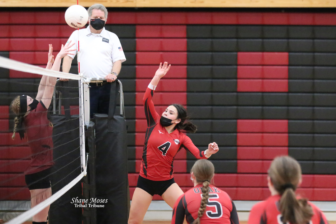Colville tribal member Trinity Fjellman (#4 red) of Omak directs the ball over the net against Lake Roosevelt in the third set on Saturday (April 3) afternoon in non-league action