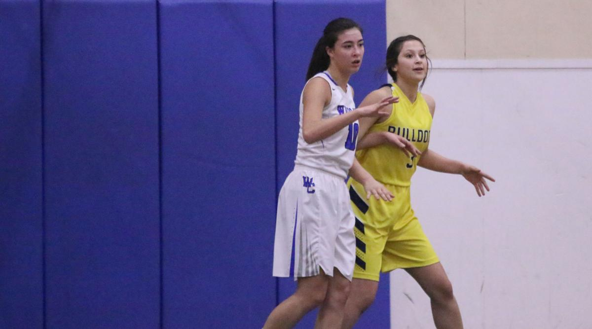 MacKenzie Arden (White) of Wilbur-Creston defends fellow Tribal member Joslynn Meusy (Yellow) of Kettle Falls in NE 2B North League action on Friday evening. Kettle Falls won 56-22