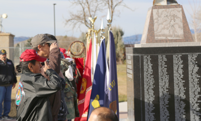 Colville tribal veterans Dave Tonasket and Duane Johnson salute the colors, Monday, during a Veterans Day event in Nespelem.