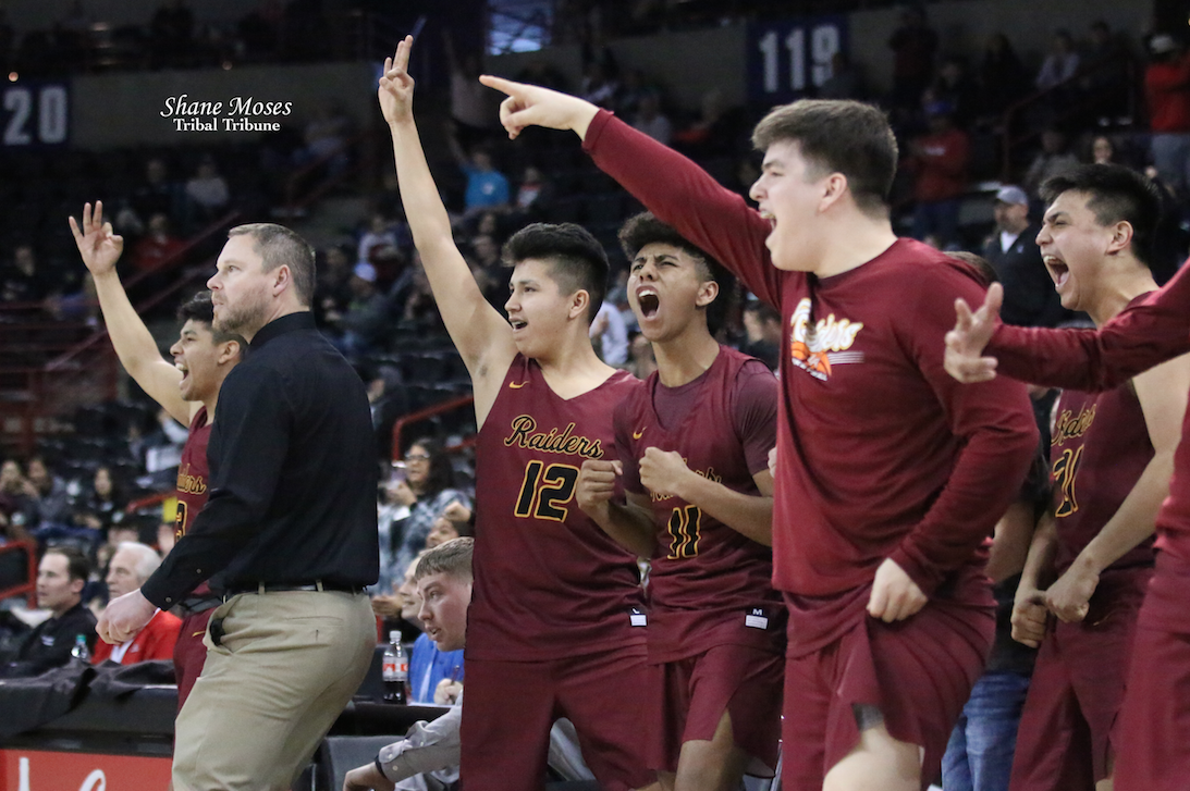 Players on the bench for Lake Roosevelt stand and cheer for their teammates against Toutle Lake in the 4th/6th place game on Saturday (March 7) morning. The Raiders held off Toutle Lake 49-46.