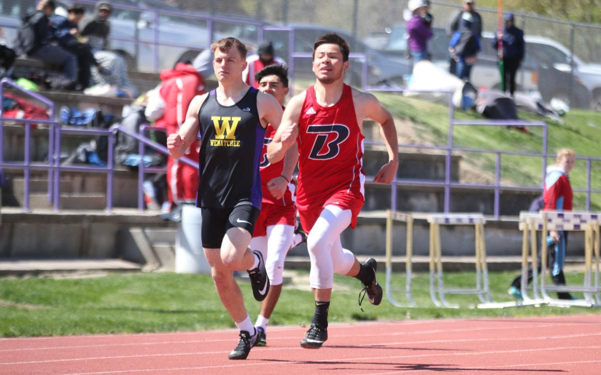 Ernie Nanamkin (red) of Brewster pushes through to the end in the 400 meters at the NCW Invite at Wenatchee on Saturday (April 27) afternoon. Nanamkin placed third in the race. He also placed second in the long jump and fourth in the javelin.