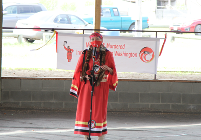 Colville tribal member Earth Feather Sovereign, president of the advocacy group Missing and Murdered Indigenous Women Washington, speaks at an event in Nespelem, May 5