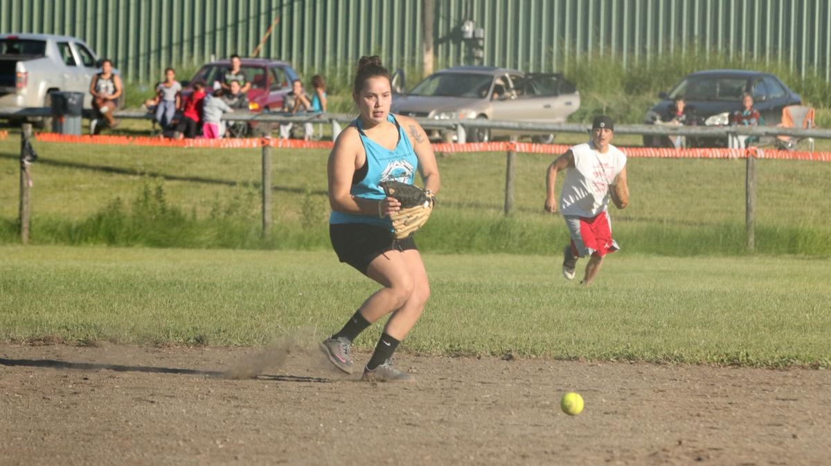Colville tribal member Leah Dick playing for Team Signor gets ready to field a ground ball on Friday evening June 15 in the 22nd annual Last Name Softball Tournament in Inchelium, Wash.