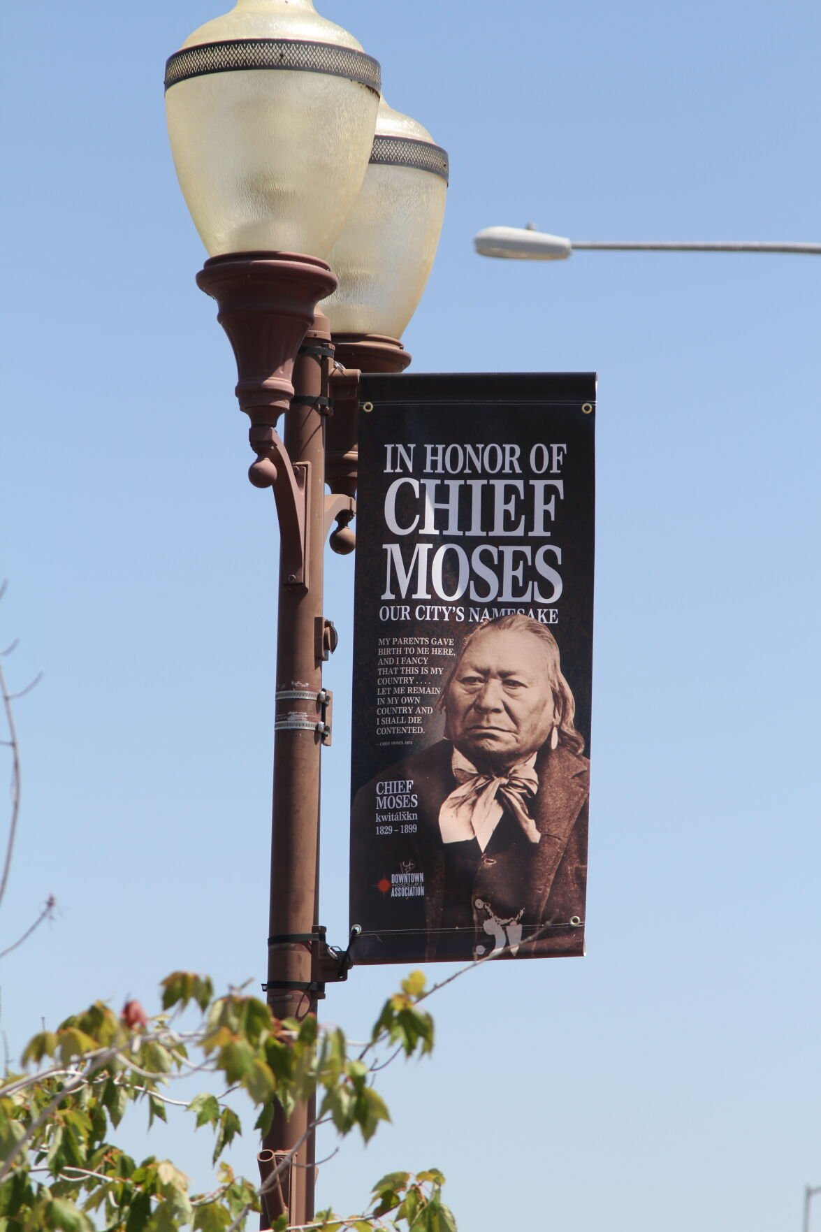 A banner of Chief Moses hangs to the side of a light post at Moses Lake's Sinkiuse Park, honoring the chief